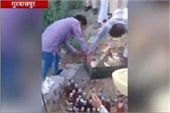 265 bottles of alcohol recovered from dirty pond