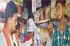 congress workers sacked ink on the picture of nathuram godse