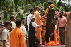 cm yogi unveils statue of chandrasekhar