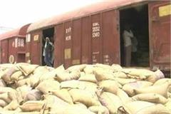fire in a stacked cargo box at railway station dozens of wheat sacks spoiled