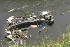 body of a young man tied with a motorcycle from a drain