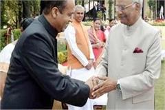 at home in the retreat cm gifted coffee table book to president
