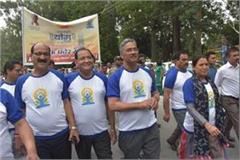 walk for yoga was organized before the yoga day