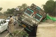 overloaded gravel truck turned