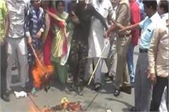 sp workers fired cm yogi s effigy sloganeering slogan