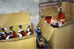 police caught liquor boxes from car driver absconding