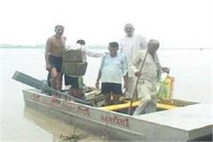 people stranded in village on the isle between yamuna