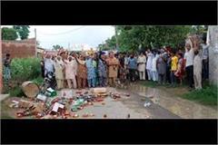 women throw bottles of liquor on the road liquor shop closed