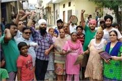 people protest with councilor against electricity board
