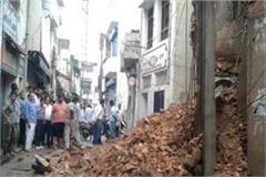 rains thrash area two storey building collapsed