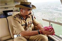 adg meerut zone showered flowers on kanwariyas from a helicopter
