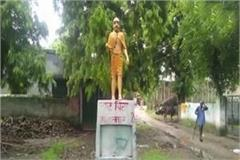 statue of mahatma gandhi painted in saffron color local people protest