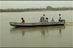 four boys immersed in yamuna