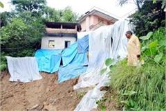 house in danger from landslide family forced to stay in tents
