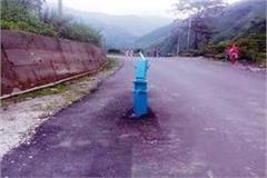 just be careful here handpump in the middle of road