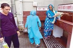 people wandering in drinking water in tanda hospital