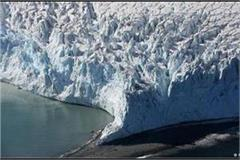 massive chunk of ice breaks from greenland glacier