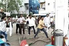 congress workers ransacked on petrol pump