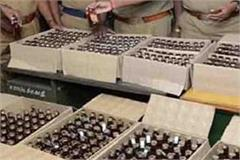 25 bags of liquor recovered from car 2 arrested