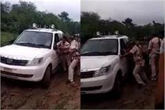 narrottam mishras car stuck in a muddy road