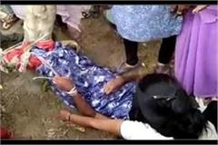 humanity shyly beating a stupid woman tied with a tree