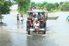kanpur dm observes the flood affected areas by tractor