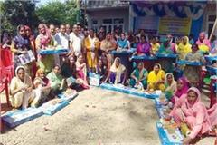 mla distributes the gas stove to 241 women