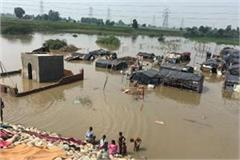 water chitti bei jalandhar nakodar highway enters fields huts