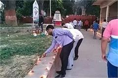 thousands of lamps were lit at the martyr s place amidst the filth