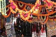 kullu market adorned with diwali people busy shopping