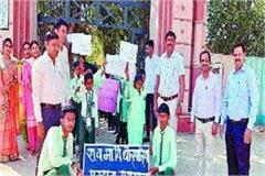 students organized a voter awareness rally in the village