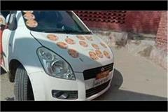 bjp candidate enters booth area with sticker car commotion