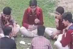 children playing cards in school uniforms