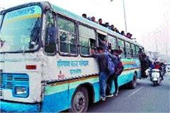 unaided student in front of bus traveling on roof and window