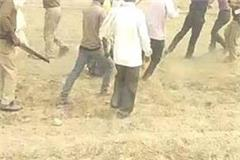 mathura police fight over government land mute spectator video viral