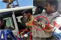 video of two excise workers doing illegal recovery goes viral