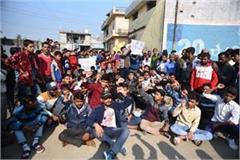 children protest outside school after dhananjay death