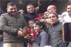 uncle we want to go to school children said by giving flowers to sp