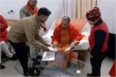 yogi reprimanded for delay in construction of women s