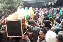 the dead body of martyr son in a tricolor