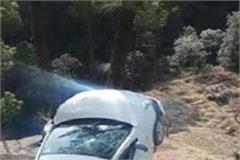 a car stuck on a tree suddenly falling into a deep ditch
