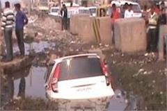car caught in a dirty nullah a boy with a driver and a car survivor