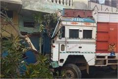 truck collides with three shops