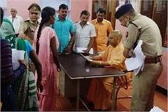 yogi put the public court in gorakhpur listened to people s problems