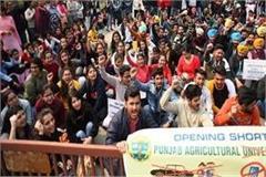 pau students put a lock university gate sloganeering
