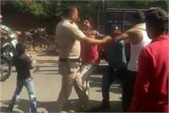 policeman slapped woman crowd beaten him