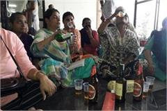 in government office women protested with wine and beer