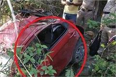 car rolled into a deep ditch on nh 205