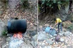 police raid in forest destroy the raw liquor and furnace