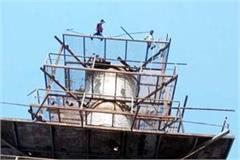 laborers climbing on tower after getting not salary